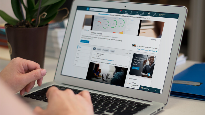InPhase Linkedin page displayed on a laptop